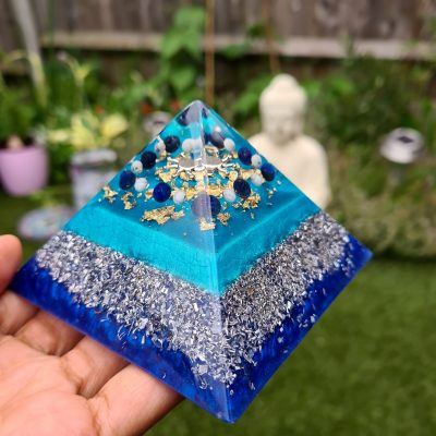 holding an orgonite pyramid