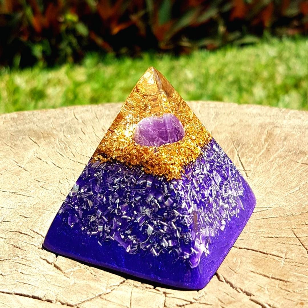 the Amethyst mini pyramid   Amethyst is a beautiful, powerful crystal which aides in calming your central nervous system, dissolving negativity and enhancing your intuition. It also has protective energy and is often used to help those suffering with different addictions. Is there anything it can't do!  When working with crystals and other spiritual practices it's important to remember they compliment one another and work best as a team. There is no magic pill but when we commit to holistic healing and health, it can be extremely powerful for your whole mind, body and soul!  It's about being open to the magic... but staying grounded at the same time      